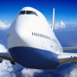 Airplane at fly on the sky with clouds — Stock Photo #6370806