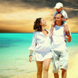 View of happy young family having fun on the beach — Stock Photo #6370815