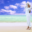 Young beautiful women in the white on the beach — Stock Photo #6370831