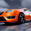 Beautiful orange sport car on road — Stock Photo