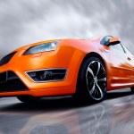 Beautiful orange sport car on road — Stock Photo #6370854