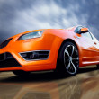 Foto Stock: Beautiful orange sport car on road