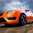 Beautiful orange sport car on road — Stock Photo