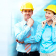 Young architects wearing a protective helmet standing on the bui — Stock Photo #6370888