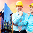 Young architects wearing a protective helmet standing on the bui — Stock Photo #6370889
