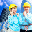 Young architects wearing a protective helmet standing on the bui — Stock Photo #6370890