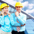 Young architects wearing a protective helmet standing on the bui — Stock Photo #6370895
