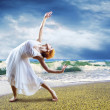 Woman dancer posing on the beach — Stock Photo #6370939