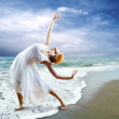 Woman dancer posing on the beach — Stock Photo