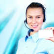 Happiness businesswoman speak in headphones on blur business arc — Stockfoto