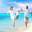 View of happy young family having fun on the beach — Stock Photo #6370998