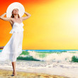 Young beautiful women in the white with pareo on the sunny tropi — Stock Photo #6371015