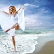 Woman dancer posing on the beach — Stock Photo #6371031