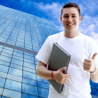 Young happy man or student with laptop and phone on the business — Stock Photo