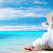 Young beautiful women in the white on the sunny tropical beach — Stock Photo #6371142