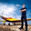 Man on the top of mountain and airplane - Stockfoto