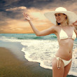 Young beautiful women in the white on the sunny tropical beach — Stock Photo #6371162
