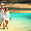 View of happy young family having fun on the beach — Stock Photo #6371178