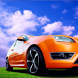 Beautiful orange sport car on road — Stock Photo #6371186
