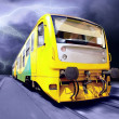 Stock Photo: Yellow train on speed outdoor