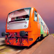 Orange train on speed outdoor — Stock Photo