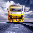 Yellow train on speed outdoor — Zdjęcie stockowe
