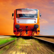 Orange train on speed outdoor - Stock Photo