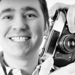 Happiness man with vintage photo camera. — Stock Photo #6371344