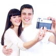 Young beauty couple with photo camera isolated on white backgrou — Stock Photo