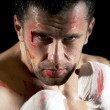 Aggressive boxer with blood on the face — Stock Photo #6371403