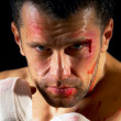 Aggressive boxer with blood on the face — Stock Photo #6371405