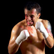 Aggressive boxer with blood on the face — Stock Photo #6371408