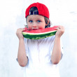 Child with part of watermelon, isolated on the white background — Stockfoto