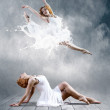 Woman dancer seating posing on background — Stock Photo #6371466