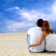 Stock Photo: Young couple seating in desert in sunny day