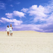 Happiness family fun in desert in sunny day — Stock Photo