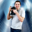 Happiness man with vintage photo camera — Stock Photo #6371640