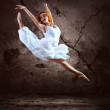 Woman dancer jump posing on background — Stock Photo #6371650