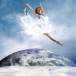 Jump of ballerina with dress of milk — Stock Photo #6371665