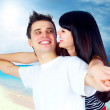 Beautiful couple on the sunny tropical beach — Stock Photo #6371670