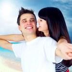 Beautiful couple on the sunny tropical beach — Stock Photo