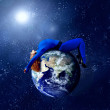 Woman in blue sleeping on the planet in space. — Stock fotografie