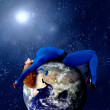 Woman in blue sleeping on the planet in space. — Stock Photo