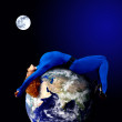 Woman in blue sleeping on the planet in space. — Stock fotografie #6371687