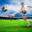 Foto Stock: Happiness football player after goal on field of stadium wit