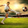 Happiness football player after goal on the field of stadium wit — Stock Photo #6371701
