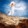 Beautiful girl in White on the mauntain under sky with clouds — Stock Photo #6371723