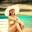 Young beautiful women on the sunny tropical beach in white bikin — Stock Photo