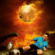 Football player in fires flame on the outdoors field — Stock Photo #6371740