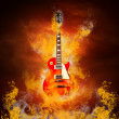 rock guita in flames of fire — Stock Photo #6371802